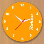 Bright yellow colored wall clock personalized with name